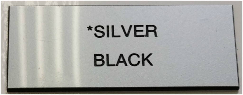 silver_and_black_letters